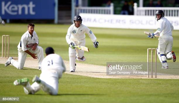 New Zealand's James Marshall runs in safe from a throw from Kent's Niel Dexter during the tour match at the St Lawrence Ground Canterbury