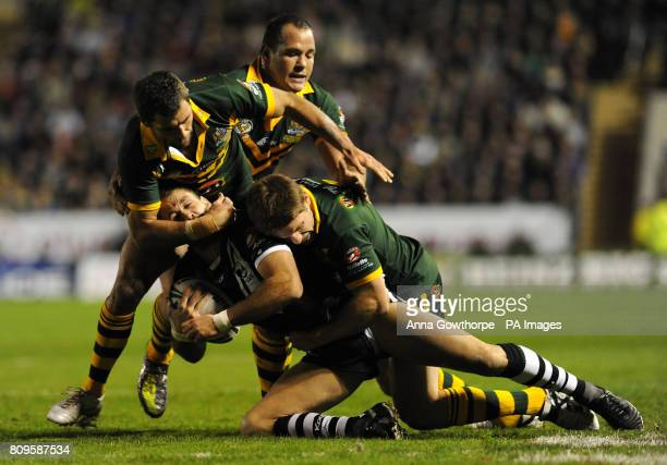 New Zealand's Jason Nightingale is tackled by Australia's Cameron Smith and Chris Lawrence during the Gillette Four Nations match at the Halliwell...