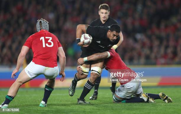 New Zealand's Jerome Kaino is tackled by British and Irish Lions' Taulupe Faletau during the third test of the 2017 British and Irish Lions tour at...