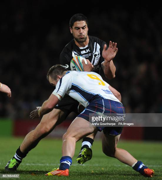 New Zealand's Jesse Bromwich is tackled by Scotland's Ian Henderson during the World Cup Quarter Final match at Headingley Stadium Leeds