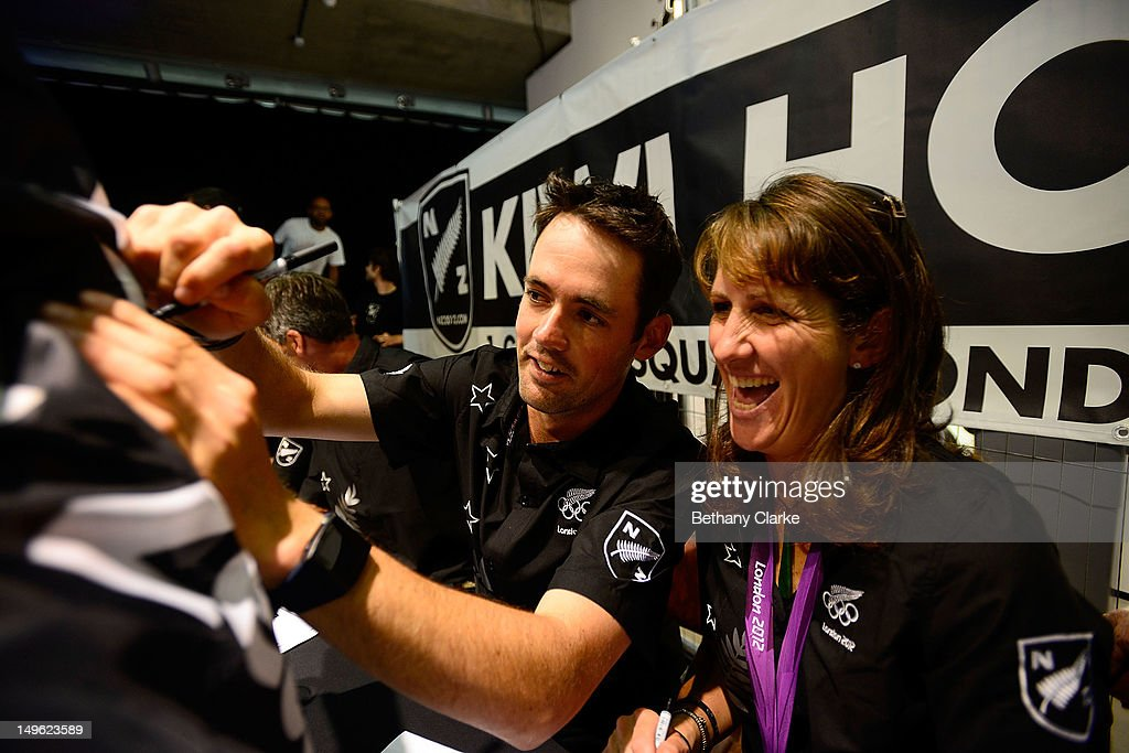 New Zealand's Jonathan Paget and Caroline Powell sign autographs during a Visit Kiwi House on August 1, 2012 in London, England. New Zealand won their first medal at the London Olympics after they picked up bronze in the team's competition of the three-day eventing.