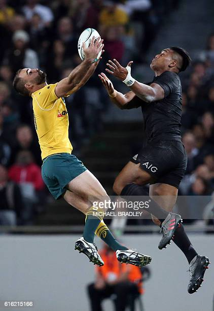 New Zealand's Julian Savea competes for the ball with Australia's Nick Frisby during the third rugby Bledisloe Cup Test between the New Zealand All...
