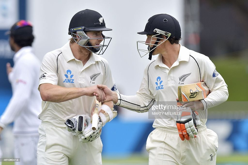 New Zealand's <a gi-track='captionPersonalityLinkClicked' href=/galleries/search?phrase=Kane+Williamson&family=editorial&specificpeople=4738503 ng-click='$event.stopPropagation()'>Kane Williamson</a> (L) shakes hands with batting partner <a gi-track='captionPersonalityLinkClicked' href=/galleries/search?phrase=BJ+Watling&family=editorial&specificpeople=2115739 ng-click='$event.stopPropagation()'>BJ Watling</a> as they walk off the ground for lunch on day four of the second international Test cricket match between New Zealand and Sri Lanka at the Basin Reserve in Wellington on January 6, 2015. AFP PHOTO / MARTY MELVILLE