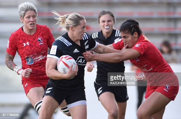 New Zealand's Kelly Brazier fends off Canada's Bianca Farella during the final at the World Rugby Women's Sevens Series in Kitakyushu Fukuoka...