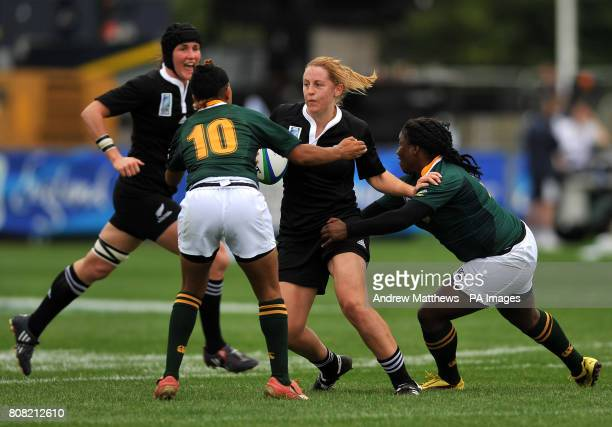 New Zealand's Kelly Brazier is tackled by South Africa's Zenay Jordaan and Phumeza Gadu during the Women's World Cup at Surrey Sports Park Surrey