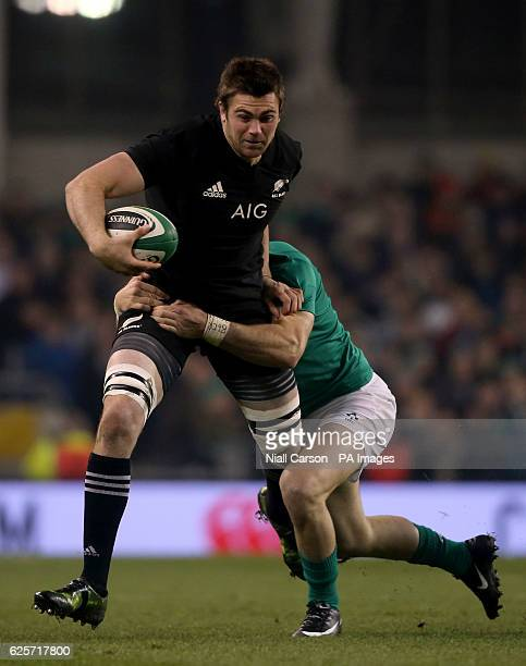 New Zealand's Liam Squire is tackled by Ireland's Robbie Henshaw during the Autumn International match at the Aviva Stadium Dublin