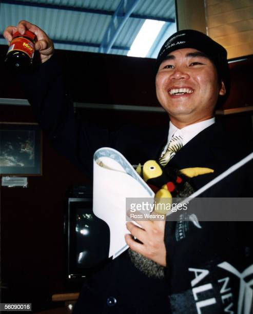 New Zealand's long awaited Four Millionth Citizen Ngoc Kim Nguyen proudly displays 'Kiwi Icons' Marmite and a Buzzy Bee after he received his New...