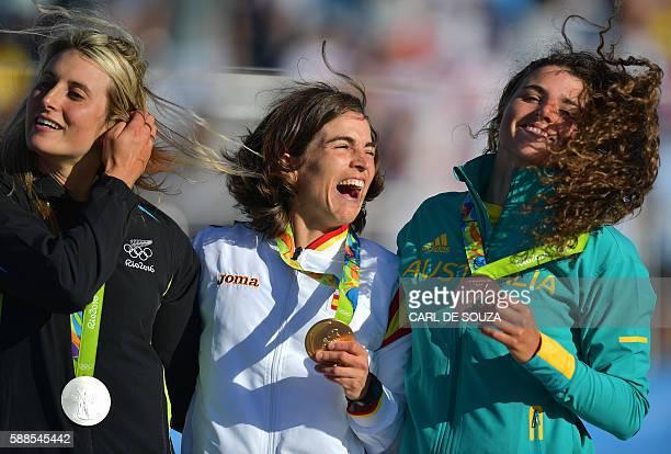 New Zealand's Luuka Jones Spain's Maialen Chourraut and Australia Jessica Fox celebrate with their medals on the podium of the Women's K1 final kayak...