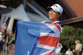 New Zealand's Lydia Ko celebrates with the New Zealand national flag after winning the Evian Championship on September 13 2015 in the French Alps...