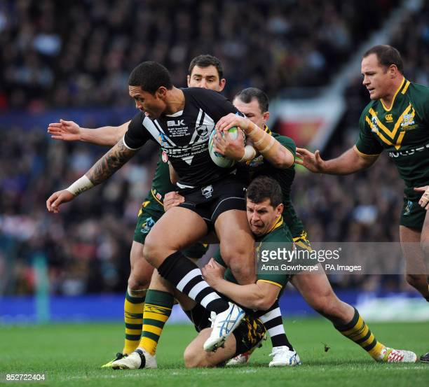 New Zealand's Manu Vatuvei is tackled by a strong Australia defence during the Rugby League World Cup Final at Old Trafford Manchester