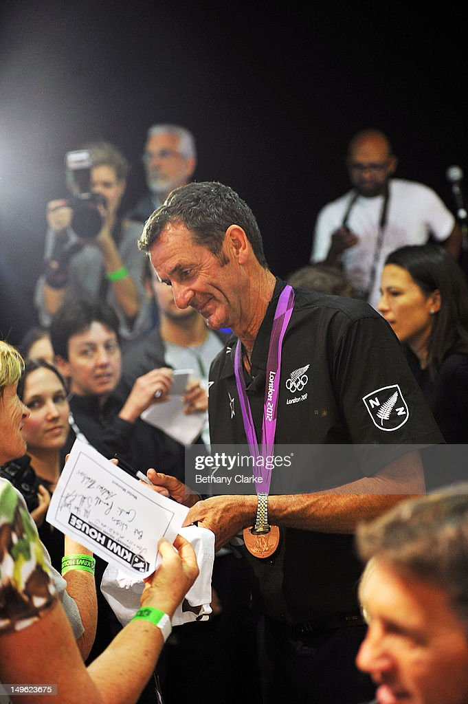 New Zealand's <a gi-track='captionPersonalityLinkClicked' href=/galleries/search?phrase=Mark+Todd&family=editorial&specificpeople=839194 ng-click='$event.stopPropagation()'>Mark Todd</a> signs autographs during a Visit Kiwi House on August 1, 2012 in London, England. New Zealand won their first medal at the London Olympics after they picked up bronze in the team's competition of the three-day eventing.
