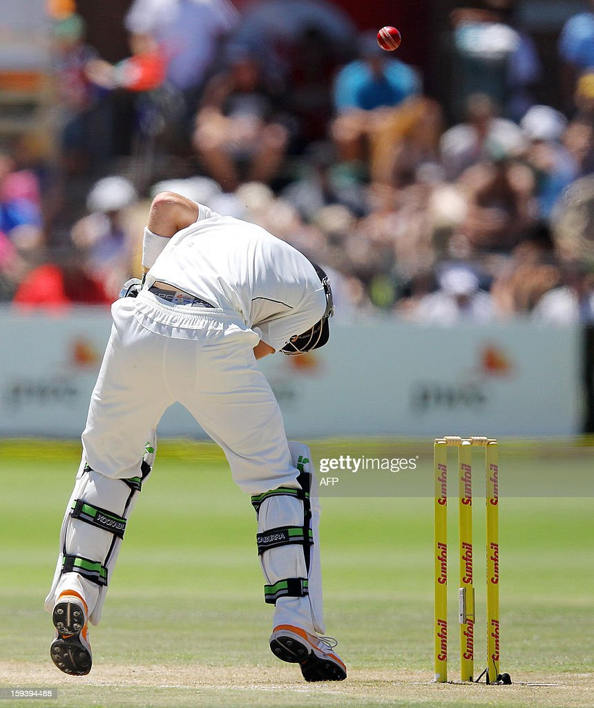 New Zealand's Martin Guptill is hit on the head by a ball on January 13, 2013 during the third day of the second and final Test against South Africa at St George's Park in Port Elizabeth. AFP PHOTO / Anesh Debiky
