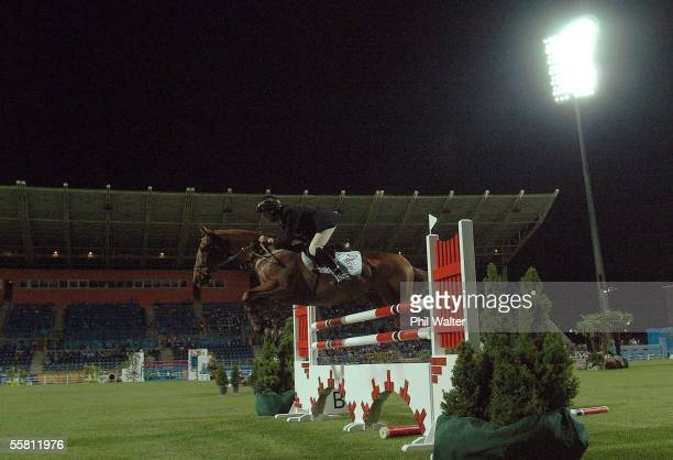 New Zealand's Matthew Grayling on his horse Revo jumps a fence in the Individual Showjumping underlights at the Markopoulo Equestrian Centre at the...