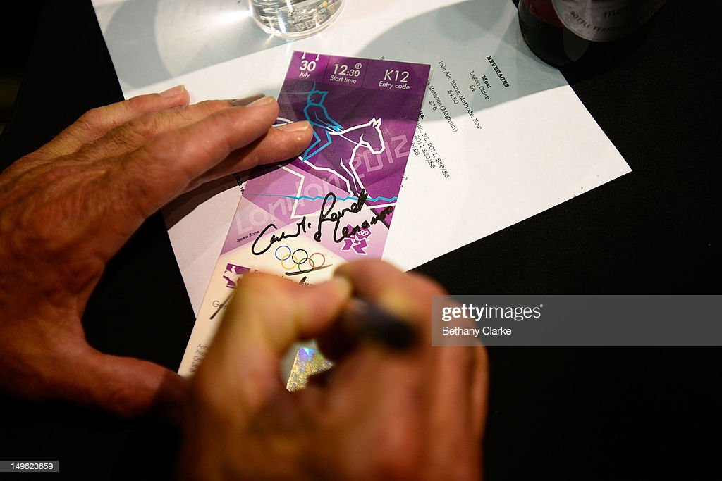 New Zealand's medalists sign autographs during a Visit Kiwi House on August 1, 2012 in London, England. New Zealand won their first medal at the London Olympics after they picked up bronze in the team's competition of the three-day eventing.