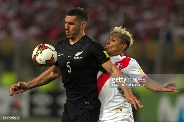 New Zealand's Michael Boxall and Peru's Raul Ruidiaz vie for the ball during their 2018 World Cup qualifying playoff second leg football match in...