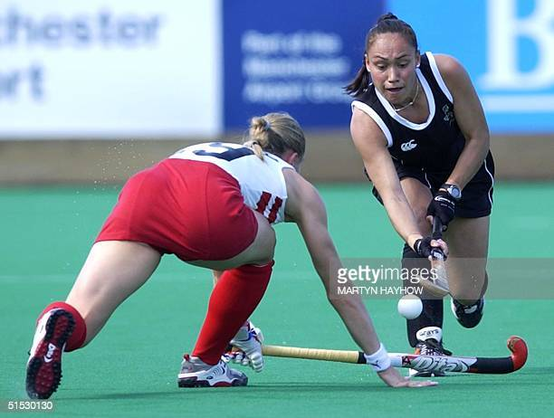 New Zealand's midfielder Caryn Paewai tries to get past Kate Walsh of England in the match at Belle Vue Stadium in Manchester 26 July 2002 on the...