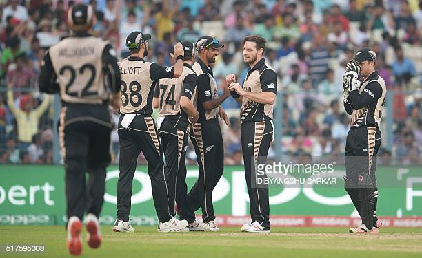 New Zealand's Mitchell McClenaghan celebrates with teammates after the dismissal of Bangladesh's Mohammad Mithun during the World T20 cricket...