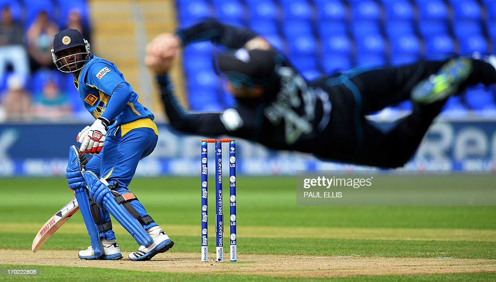 New Zealand's Nathan McCullum (R) catches Sri Lanka's Kusal Perera off the first ball during the 2013 ICC Champions Trophy cricket match between Sri Lanka and New Zealand at The Cardiff Wales Stadium in Cardiff, Wales, on June 9, 2013.