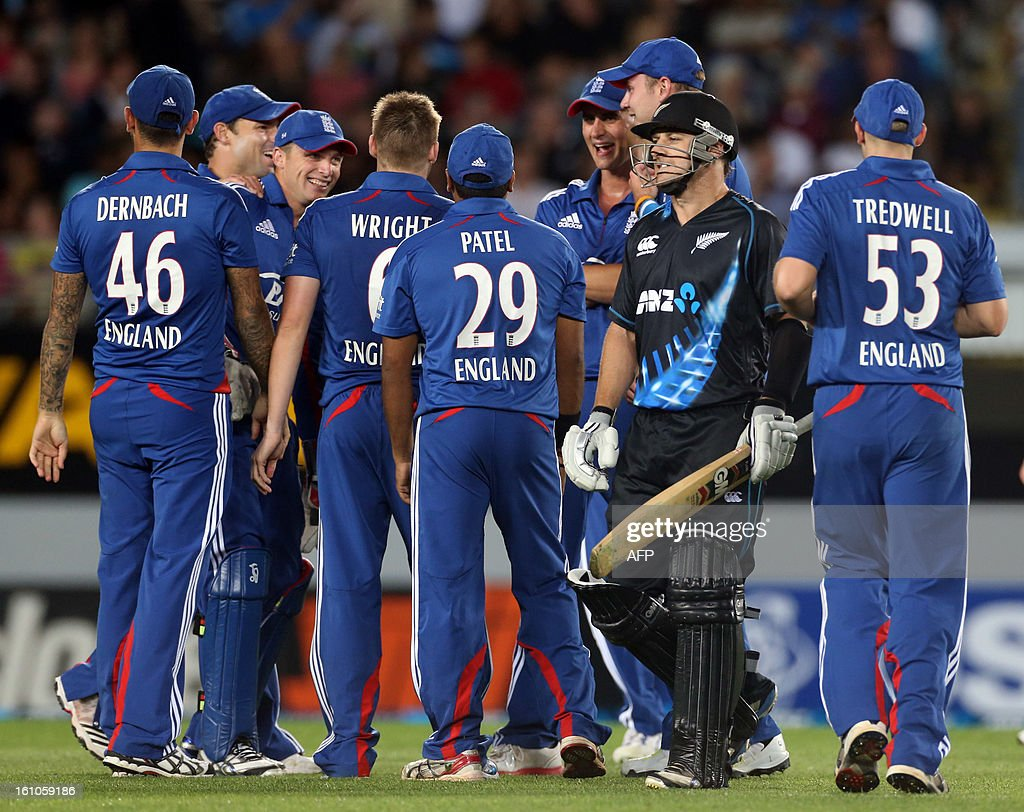 New Zealand's Nathan McCullum is dismissed for 3 runs as England celebrates during the International Twenty20 cricket match between New Zealand and England played at Eden Park in Auckland on Febuary 9, 2013. AFP PHOTO / Michael BRADLEY
