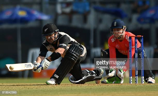 New Zealand's Nathan McCullum is watched by England's wicketkeeper Jos Buttler as he plays a shot during a warmup match between New Zealand and...