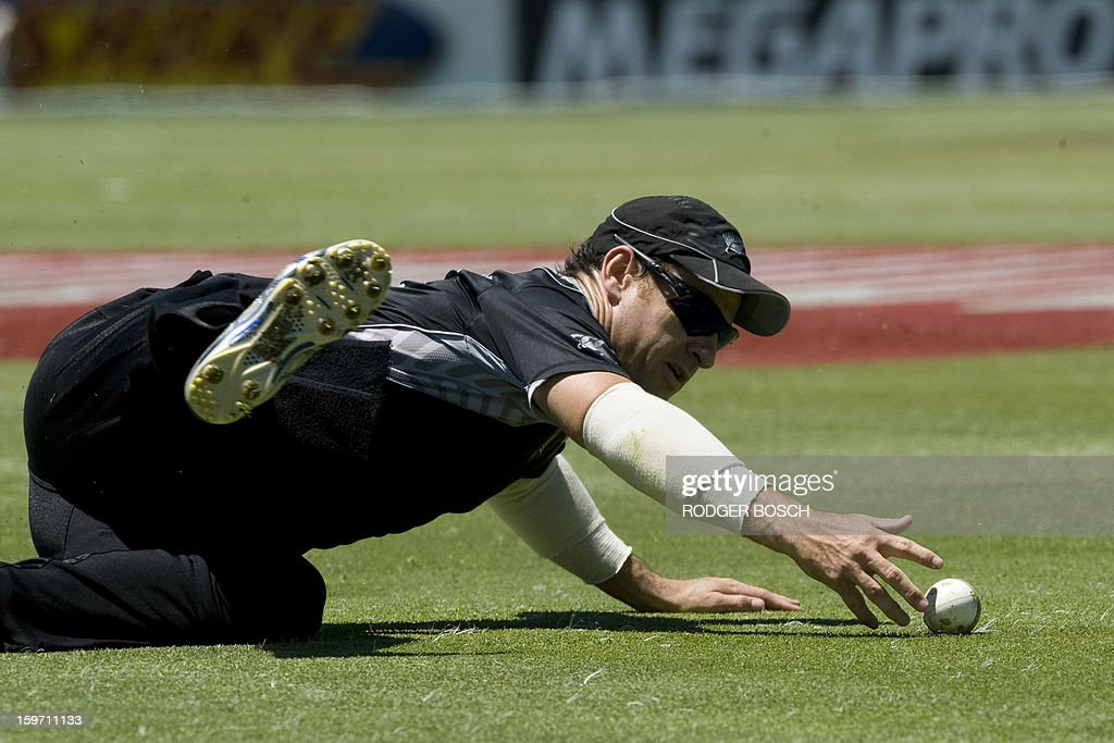 New Zealand's Nathan McCullum slides to catch a ball hit during the first One Day International (ODI) between South Africa and New Zealand, on January 19, 2013 at Boland Park, in Paarl about 60Km North of Cape Town. BOSCH