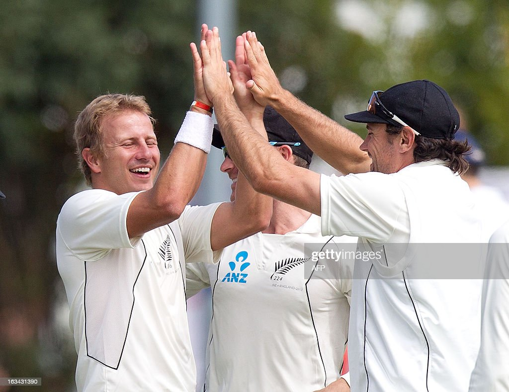 New Zealand's Neil Wagner (L) celebrates with team mate Dean Brownlie after England's Kevin Pietersen was caught out during day five of the first international cricket test match between New Zealand and England played at the University Oval park in Dunedin on March 10, 2013. AFP PHOTO / Marty MELVILLE