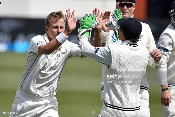 New Zealand's Neil Wagner celebrates with teammate BJ Watling after dismissing Udara Jayasundera of Sri Lanka during day four of the first...