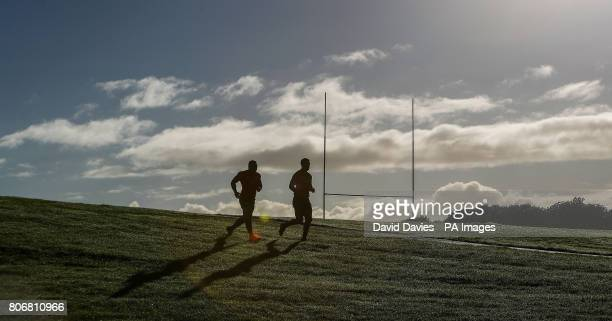New Zealand's Ngani Laumape and Anton LienertBrown arrive for their training session at The Trust Arena Henderson