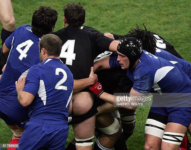 New Zealand's Norman Maxwell has his shorts pulled down during their match against France 27 November 2004 at the Stade de France in SaintDenis near...