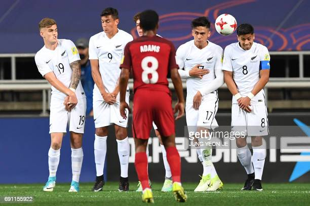 New Zealand's players attempt to block a freekick by USA's Brooks Lennon during their U20 World Cup round of 16 football match between the US and New...
