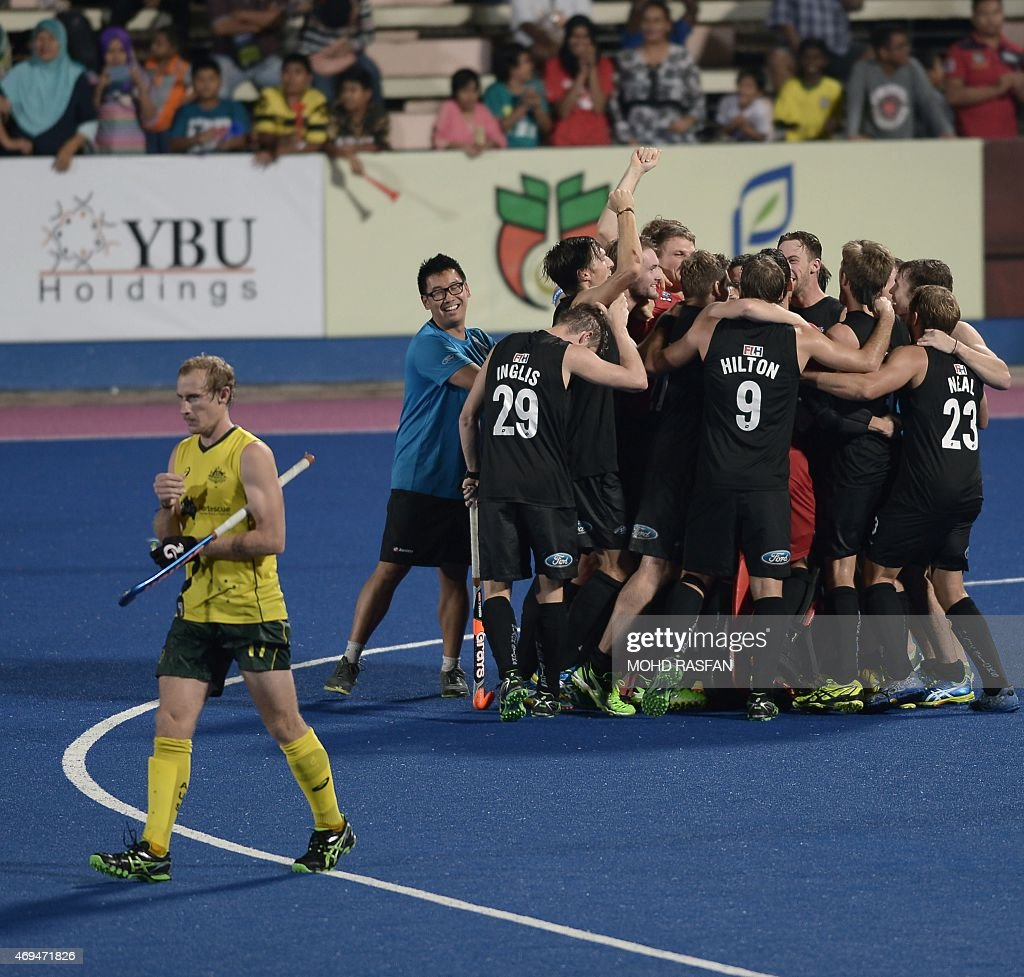 New Zealand's players celebrate after winning the Sultan Azlan Shah Cup men's field hockey tournament finals against Australia in Malaysia's northern...