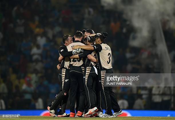 New Zealand's players celebrate after winning the World T20 cricket tournament match against India at The Vidarbha Cricket Association Stadium in...