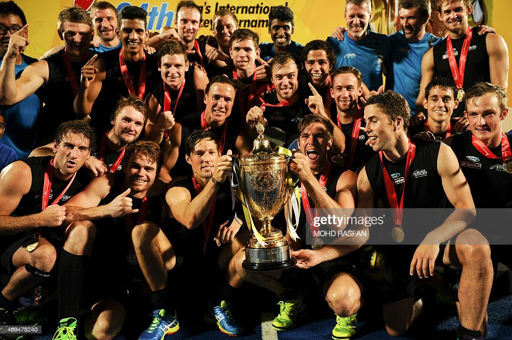 New Zealand's players celebrate with their trophy after winning the Sultan Azlan Shah Cup men's field hockey tournament finals against Australia in...