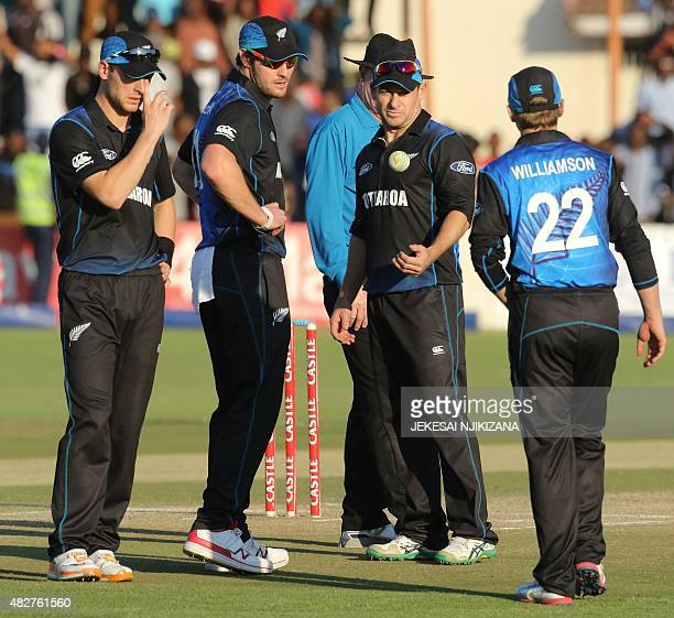 New Zealand's players talk before electing Nathan McCullum to bowl the final over during the first game in a series of three One Day International...