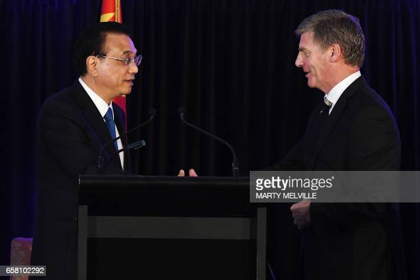 New Zealand's Prime Minister Bill English shakes hands with China's Premier Li Keqiang after a joint press conference in Wellington on March 27 2017...