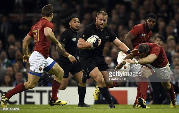 New Zealand's prop Joe Moody runs throught the French defence during the quarter final match of the 2015 Rugby World Cup between New Zealand and...