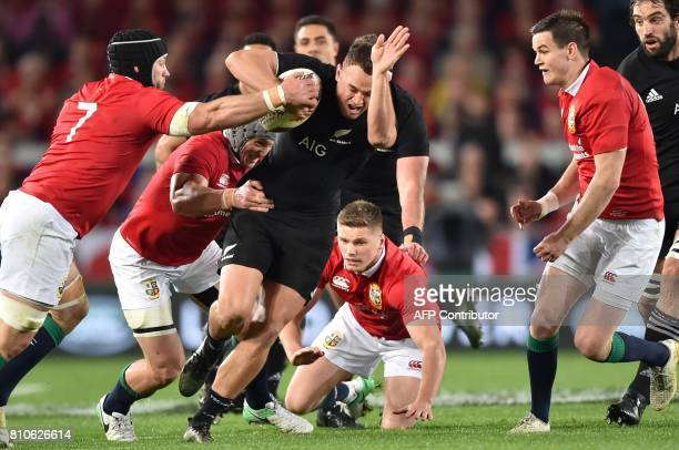 New Zealand's right wing Israel Dagg is tackled by British and Irish Lions outside centre Jonathan Davies openside flanker Sean O'Brien and flyhalf...