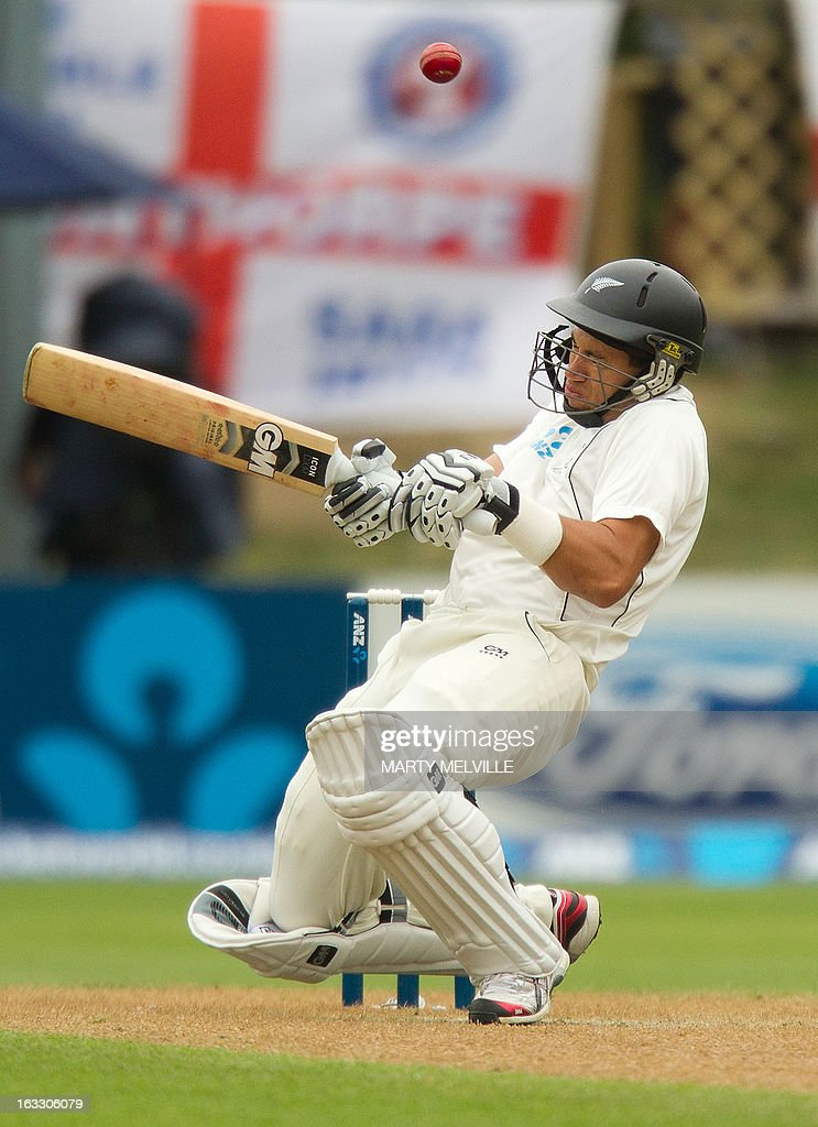 New Zealand's Ross Taylor ducks a bouncer during day three of the first international cricket test match between New Zealand and England played at the University Oval park in Dunedin on March 8, 2013. AFP PHOTO / Marty MELVILLE