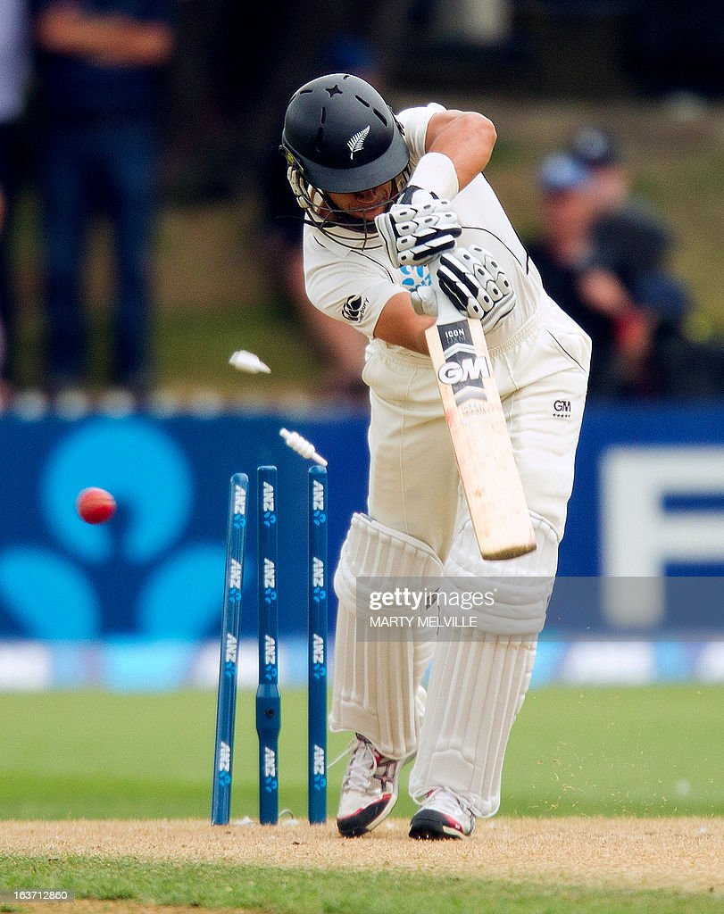 New Zealand's Ross Taylor is bowled out for a duck during day two of the second international cricket Test match between New Zealand and England at the Basin Reserve in Wellington on March 15, 2013. AFP PHOTO / Marty MELVILLE