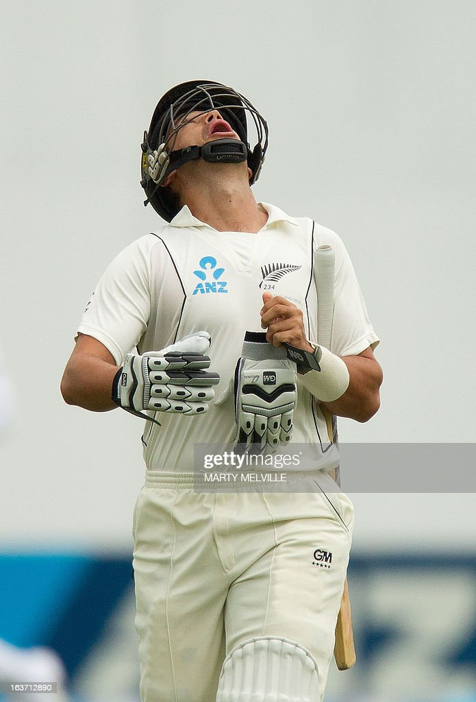 New Zealand's Ross Taylor walks from the field after being bowled out for a duck during day two of the 2nd international cricket Test match between New Zealand and England played at the Basin Reserve in Wellington on March 15, 2013. AFP PHOTO / Marty MELVILLE