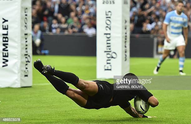 New Zealand's scrum half Aaron Smith dives and scores a try during a Pool C match of the 2015 Rugby World Cup between New Zealand and Argentina at...