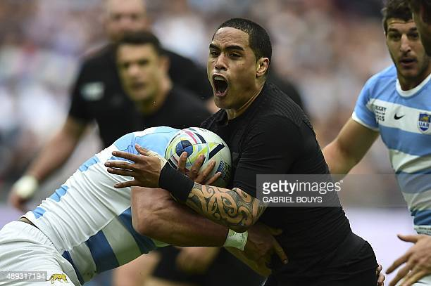 New Zealand's scrum half Aaron Smith is blocked during a Pool C match of the 2015 Rugby World Cup between New Zealand and Argentina at Wembley...