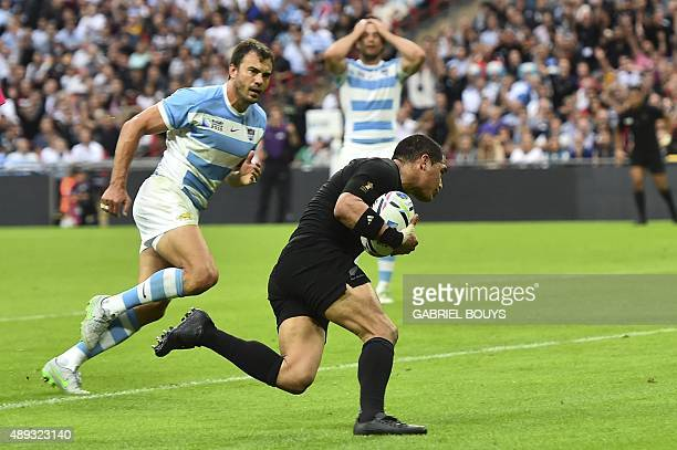 New Zealand's scrum half Aaron Smith runs to score a try during a Pool C match of the 2015 Rugby World Cup between New Zealand and Argentina at...