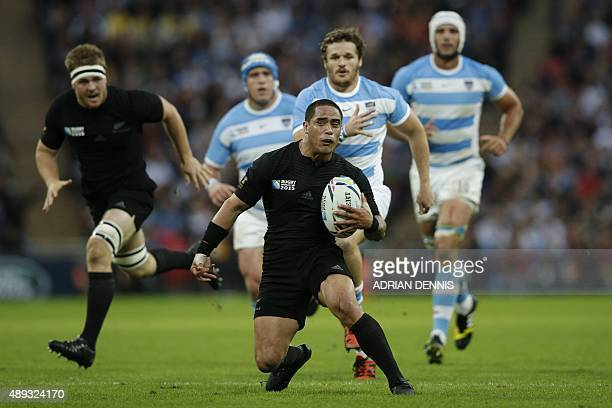 New Zealand's scrum half Aaron Smith runs with the ball during a Pool C match of the 2015 Rugby World Cup between New Zealand and Argentina at...