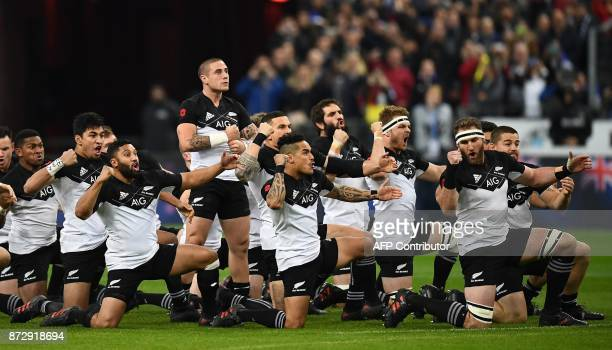 New Zealand's scrumhalf TJ Perenara stands as he leads his teammates in the Haka ahead of the friendly rugby union international Test match between...