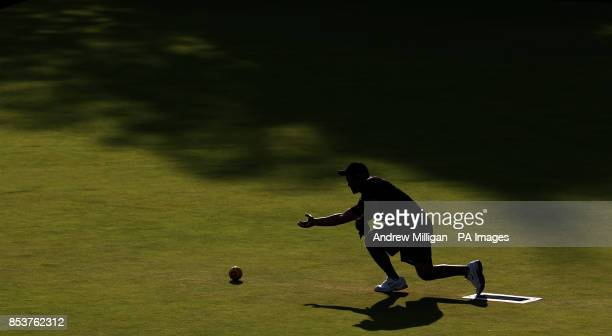 New Zealand's Shannon McILroy throws a bowl during the Men's Singles bowls bronze medal match against Australia's Aron Sherriff at Kelvingrove Lawn...