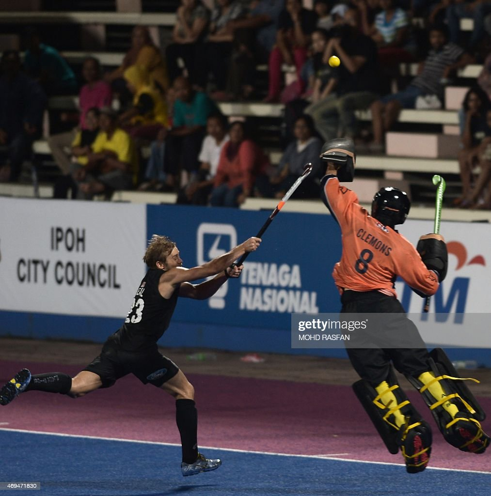 New Zealand's Shay Neal vies for the ball with Australia goalkeeper Tristan Clemons during the Sultan Azlan Shah Cup men's field hockey tournament...