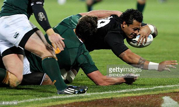 New Zealand's Sione Lauaki is tackled as he goes for a try during the TriNations rugby Test between New Zealand and South Africa at Carisbrook...