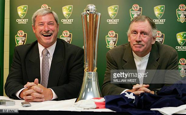 New Zealand's Sir Richard Hadlee and Australia's Ian Chappell both from large cricketing families pose with the ChappellHadlee Trophy after it was...