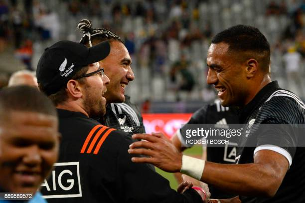 New Zealand's Teddy Stanaway and Sione Molia celebrate after winning the World Rugby Sevens Series at Cape Town Stadium on December 10 2017 in Cape...